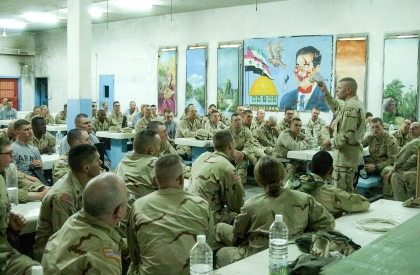 CSM Jeffrey Butler, sergeant major for the 16th MPs, addresses a group of soldiers at Abu Ghraib prison in in Feb. 2004.